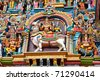 Shiva and Parvati on bull images. Sculptures on Hindu temple gopura (tower). Menakshi Temple, Madurai, Tamil Nadu, India - stock photo