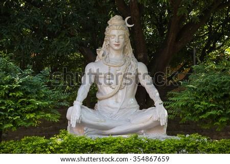 Shiva statue, Hindu idol, near on the river Ganges, Rishikesh , India - stock photo