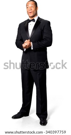 Shocked African man with short black hair in evening outfit with clasped hands - Isolated