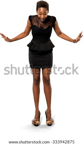 Shocked African young woman with short dark brown hair in evening outfit with arms open - Isolated