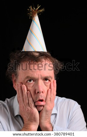 Shocked and Disappointed Business Man in a Party Hat - stock photo