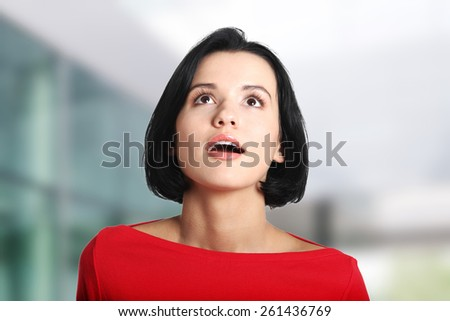 Shocked and excited woman looking up. - stock photo