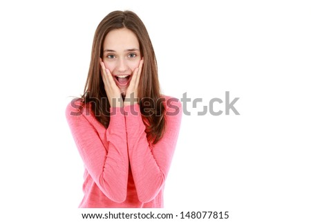 shocked and happy teen girl with hands on fACE looking at camera isolated on white