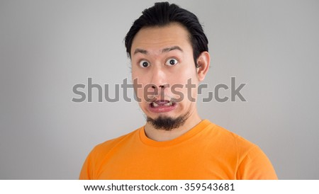 Shocked and surprised face of Asian man. - stock photo