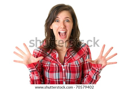 shocked and surprised young female in red shirt isolated on white background - stock photo