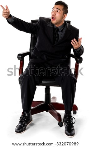 Shocked Asian man with short black hair in business formal outfit pointing using finger - Isolated