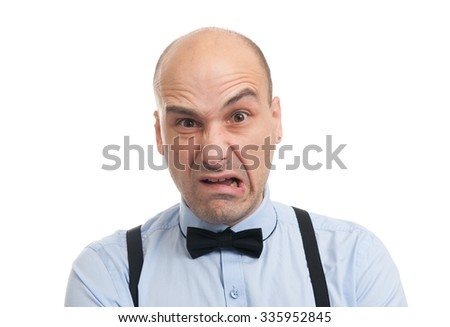 shocked bald man wearing bow tie and suspenders isolated - stock photo