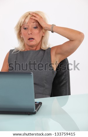 Shocked blond businesswoman - stock photo