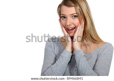 Shocked blond woman - stock photo