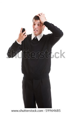 shocked businessman looking at mobile phone. isolated on white background