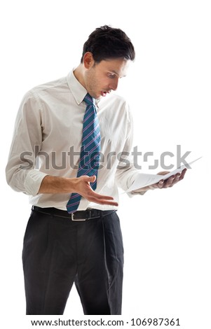 Shocked businessman looking at some documents