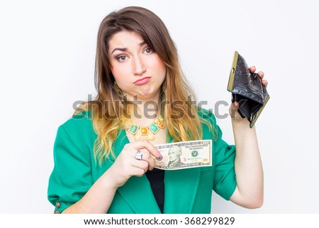 Shocked businesswoman wearing in green jacket without money, woman with wallet without money Only $ 10