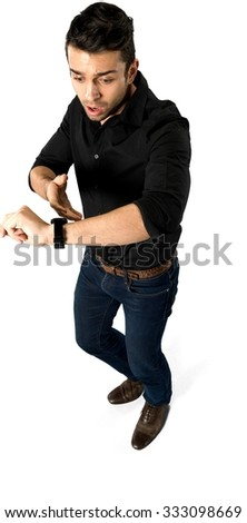 Shocked Caucasian man with short black hair in casual outfit using wristwatch - Isolated