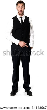 Shocked Caucasian man with short dark brown hair in business casual outfit with hands in pockets - Isolated
