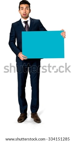 Shocked Caucasian man with short dark brown hair in business formal outfit holding large sign - Isolated - stock photo