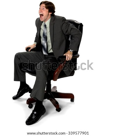 Shocked Caucasian man with short dark brown hair in business formal outfit laughing - Isolated