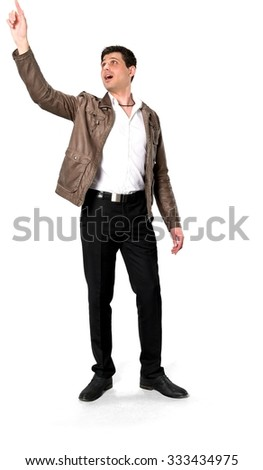 Shocked Caucasian man with short dark brown hair in casual outfit pointing using finger - Isolated