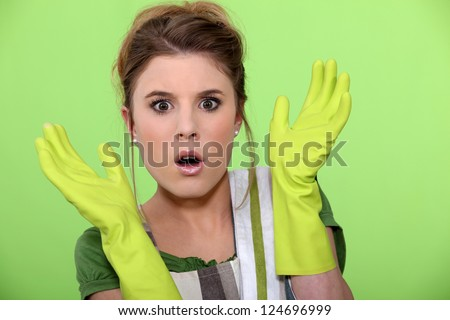 Shocked cleaning lady - stock photo