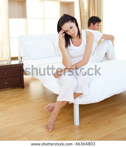 Shocked couple finding out results of a pregnancy test in the bedroom - stock photo