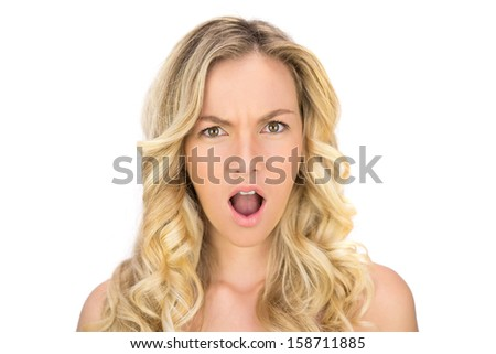 Shocked curly haired blonde posing on white background - stock photo