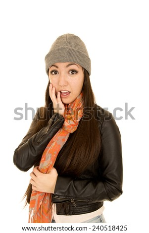 Shocked expression female model wearing winter beanie - stock photo