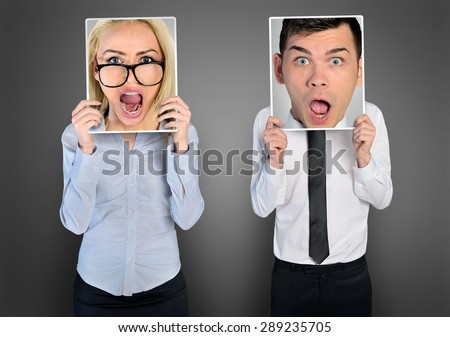 Shocked face of business woman and man - stock photo