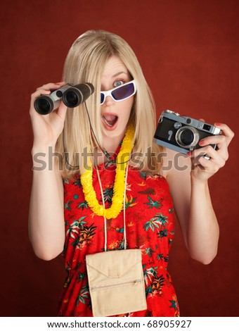 Shocked Female Tourist with Camera and Binocular in her hands - stock photo