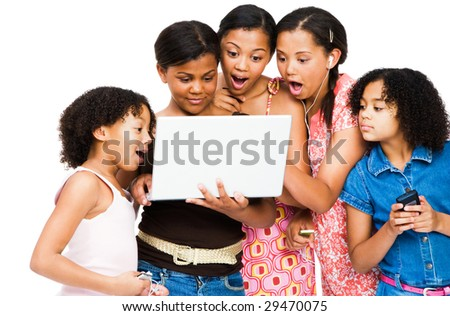 Shocked friends using a laptop isolated over white - stock photo