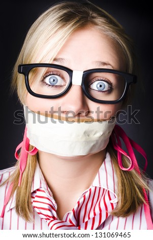 Shocked Geeky Nerd Traumatised During A Hostage Siege Whilst Being Kept Quiet With Taped Mouth - stock photo