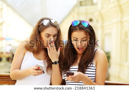 Shocked girl with mobile phone - stock photo