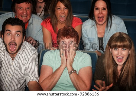 Shocked group of 7 people in theater - stock photo