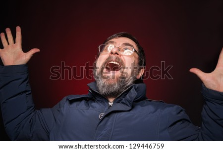 Shocked happy man on a red background