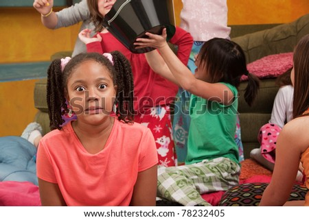 Shocked little African-American kid at a sleepover - stock photo