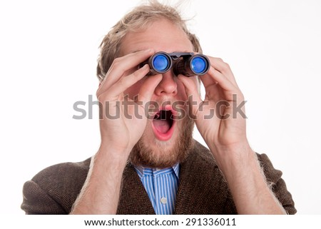 Shocked man watching through binoculars - studio shots - stock photo