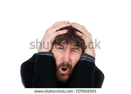 Shocked man with a beard holds hands head.isolated on white. - stock photo