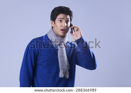 Shocked man with cell phone