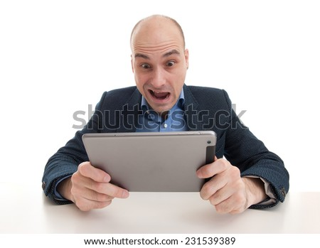 shocked man with tablet computer isolated over white - stock photo