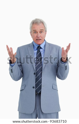 Shocked mature tradesman against a white background - stock photo