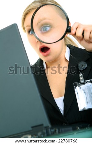 shocked or suprised business woman looking at computer using loupe - stock photo