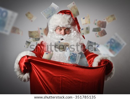 Shocked Santa Claus is looking in to the sack with Euro. Euro concept. - stock photo