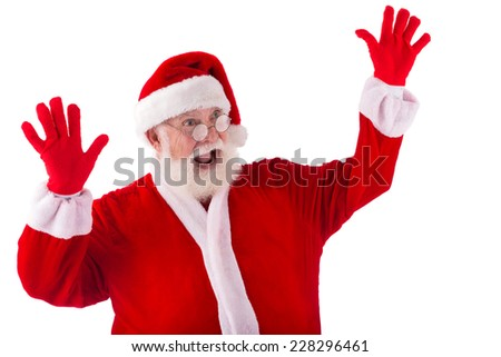 Shocked Santa Claus raising his hands - stock photo