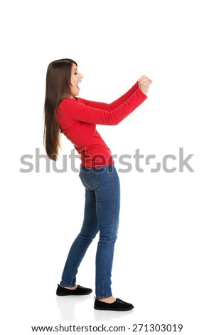 Shocked student woman holding copyspace. - stock photo