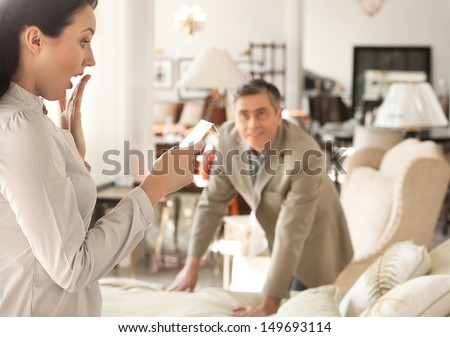 shocked price shocked middleaged woman holding stock photo 149693114 shutterstock. Black Bedroom Furniture Sets. Home Design Ideas