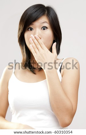 Shocked woman covering her mouth by hand.