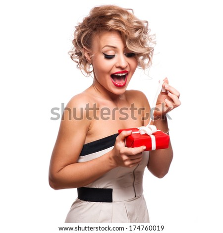 Shocked Woman holding Gift Box.White background - stock photo