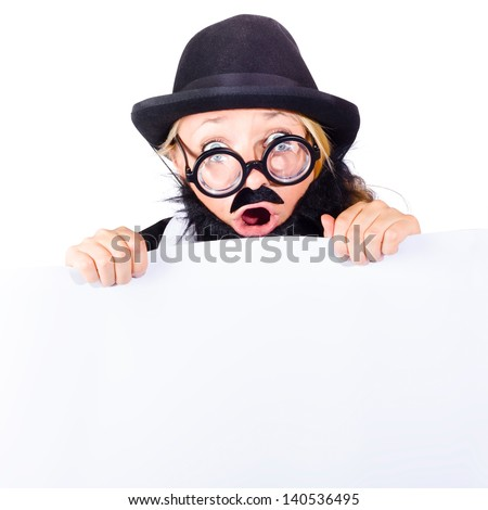Shocked woman in disguise with black bowler hat, thick rimmed glasses false beard and mustache holding onto a blank banner - stock photo