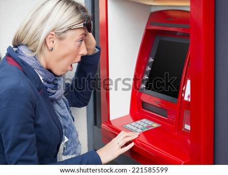 Shocked woman looking at her bank account balance - stock photo