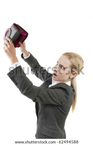 Shocked woman looking into her empty wallet