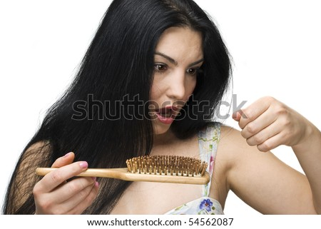 Shocked woman making a face because losing hair on hairbrush isolated on white background - stock photo