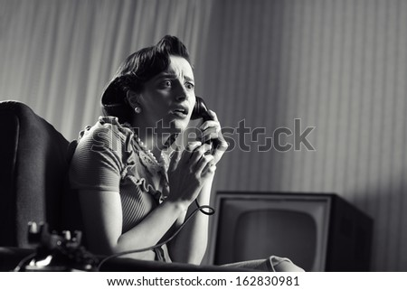Shocked Woman talking on phone, vintage image - stock photo